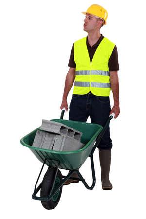 Mason pushing wheelbarrow photo