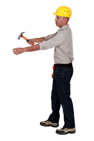 Man hammering an invisible object photo