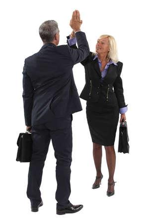 median age: Executive hitting hand