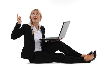 the girl in stockings: woman sitting on the floor with her laptop and having a great idea Stock Photo