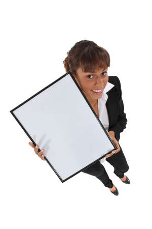 Office worker holding empty picture frame photo