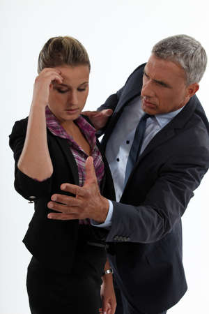 young woman having migraine comforted by mature gentleman photo