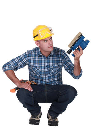 Man holding an electric sander photo