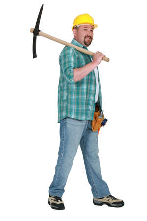 Man resting pick-axe over his shoulder photo