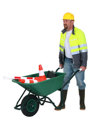 bricklayer with wheelbarrow Stock Photo - 13377655