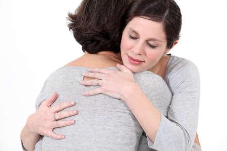two women hugging: Two women hugging