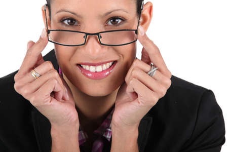 Woman adjusting her glasses Stock Photo