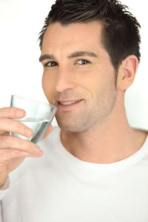 adequate: Man with a glass of water