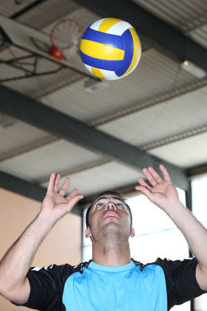 muscle guy: Man playing volleyball
