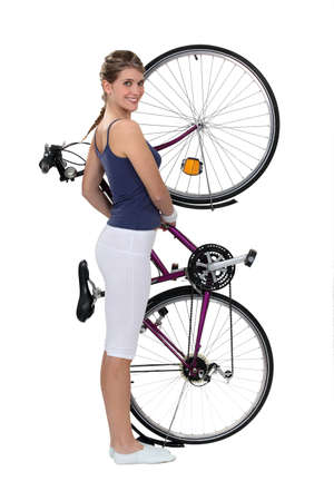 indoor: Brunette stood with bicycle