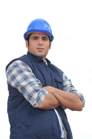 Portrait of a standoffish tradesman with his arms crossed Stock Photo - 13379715