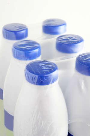 six packs: Six plastic bottles of milk