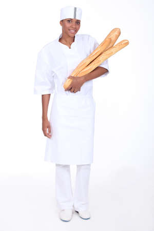 Female baker with loaves of bread Stock Photo - 13461412