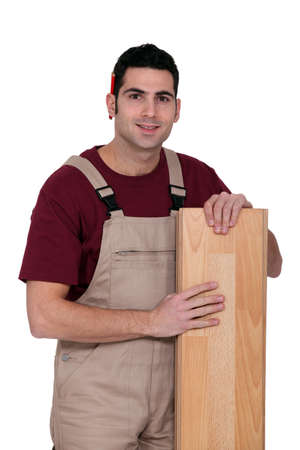 Man with parquet slat Stock Photo - 13459398