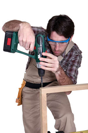 Man using an electric screwdriver photo