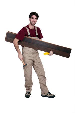 underlay: Worker carrying flooring Stock Photo