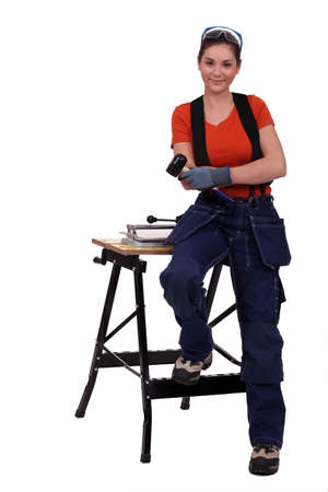tile cutter: Woman with a tile cutter Stock Photo