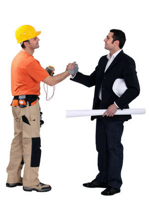 non verbal communication: Engineering forming a pact with a tradesman Stock Photo
