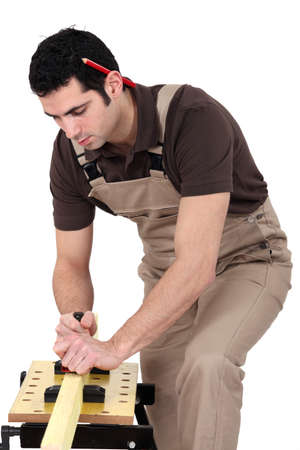 whittle: Man planning wood
