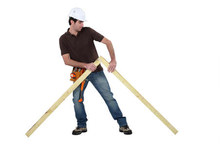 Woodworker erecting frame Stock Photo - 13448181