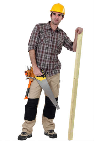 Tradesman with a saw and a wooden plank photo