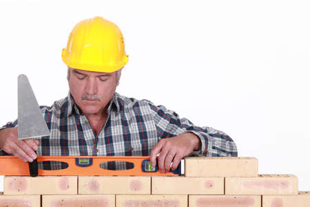 neutralize: craftsman working with a level