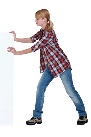 Woman pushing a blank sign Stock Photo