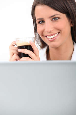 Young woman drinking coffee photo