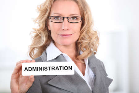 Blond office worker holding administrator  badge photo