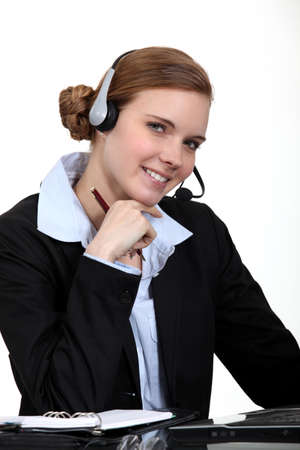 A businesswoman with a headset on  photo