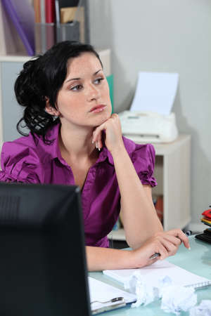 writers block: Frustrated female office worker