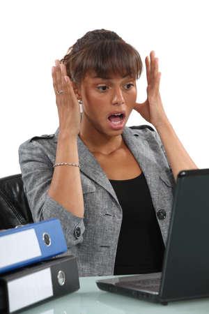 misconception: A horrified black businesswoman  Stock Photo