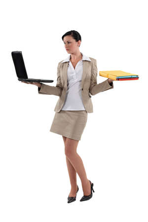 laptop stand: Woman carrying laptop and folders