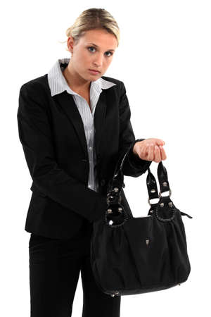 poker faced: Woman searching for something in her bag
