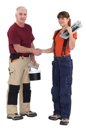 non verbal communication: Tradespeople forming a partnership