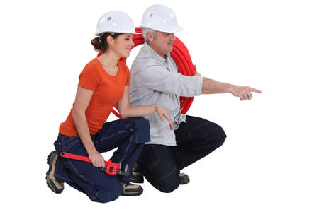 Plumber and female apprentice photo