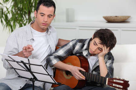 teenager having music lesson photo