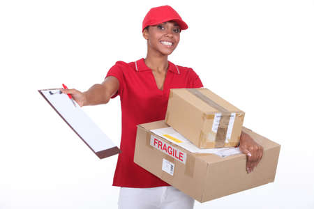 consign: Young courier delivering parcels Stock Photo