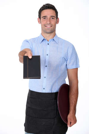 giving back: a waiter giving back a wallet