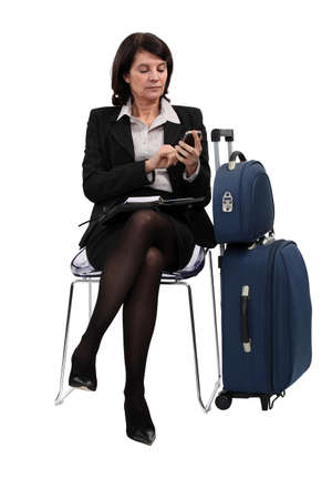 miniskirt: Seated Woman with suitcases Stock Photo