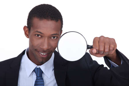 portrait of a man with magnifying glass photo