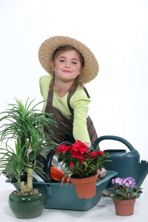 make belief: Child pretending to be a florist Stock Photo