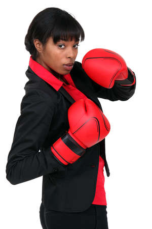 Businesswoman in boxing gloves photo