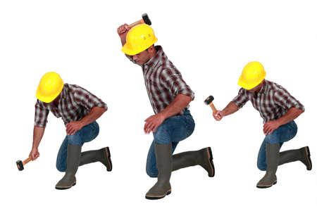 tradesperson: Tradesman using a hammer