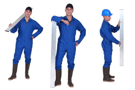 long lasting: Worker holding metal beam Stock Photo