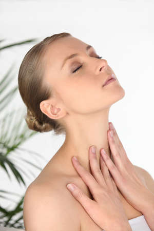 aching muscles: Woman rubbing her own neck Stock Photo