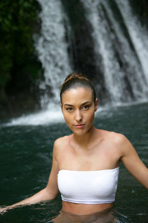 Woman in front of a waterfall photo