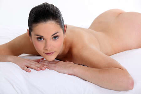 nude ass: naked woman lying on her bed