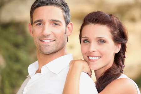 couples hug: young smiling couple Stock Photo