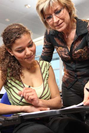 Teacher checking student photo